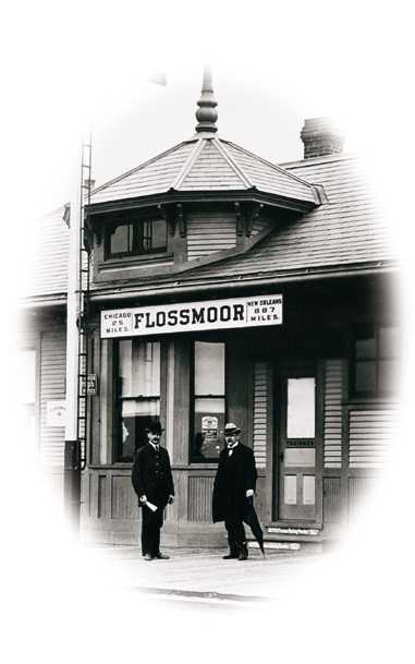 Photo of Historic Flossmoor Train Station with Men Standing in Front