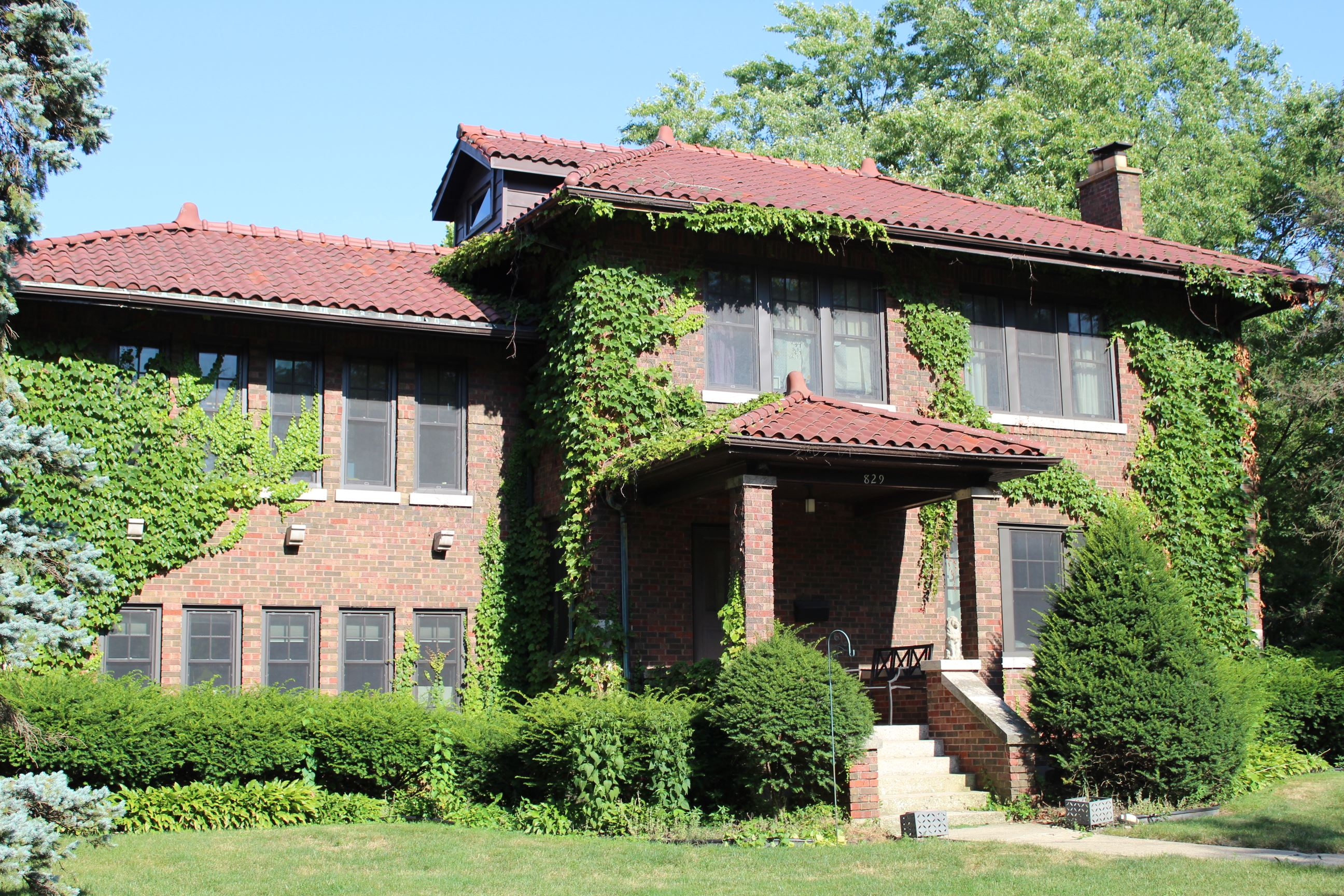 Photo of Red Brick Home with Red Clay Roof Tile on Gardner Road
